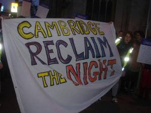 Large banner with the words 'Cambridge Reclaim the Night'